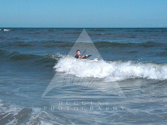 A boy rides Hatteras waves.
