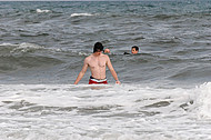 A young man in the surf