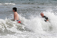 Father and son enjoy surf