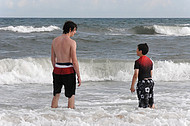 Two brothers discuss the surf